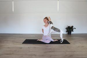 TriBalance North Brisbane yoga teacher Helena Turner in cow face pose