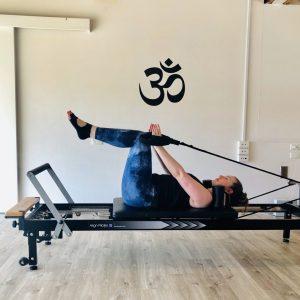 TriBalance Physiolates clinical exercise classes student spotlight Sarah Badman doing abdominal prep on reformer