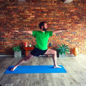 TriBalance yoga student spotlight Josh Rollinson warrior 2 pose North Brisbane