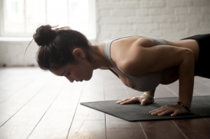 Beginner yoga course teacher doing low plank Chaturanga tribalance north Brisbane
