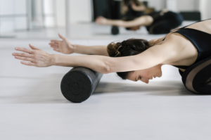 Physiolates clinical exercise classes client using foam roller tribalance North Brisbane