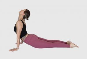 tribalance yoga teacher cathy aganoff doing upward facing dog live stream classes
