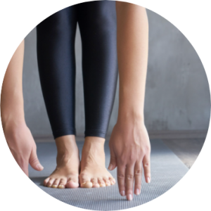 Beginner yoga course student touching toes at TriBalance North Brisbane.