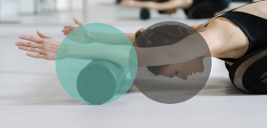 TriBalance Physiolates clinical exercise student using foam roller in childs pose